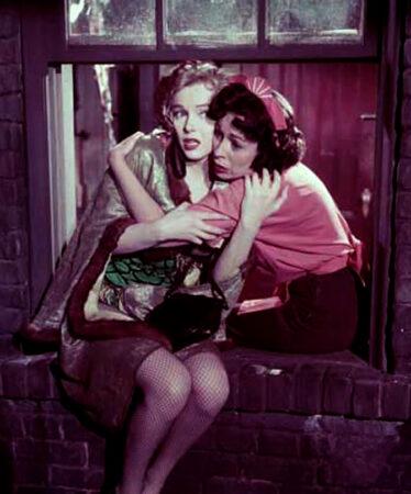 Mom hugging Marilyn in window